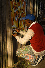 JoJo Fekwa will be painting again at Art in the Alley. You've seen his work all over town (mural at Trinidad and Florida, for example).